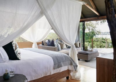 Luxury Tented Suite - bedroom with river view